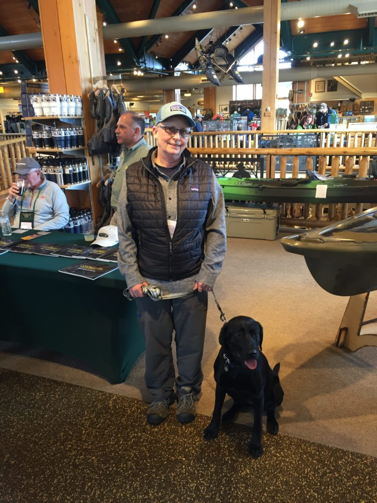 Capt. Avery and her dog Bigelow at the LL Bean Spring Fishing Expo